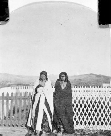 Two Men in Blankets near Wood Fence, Bannock Agency, Wyoming