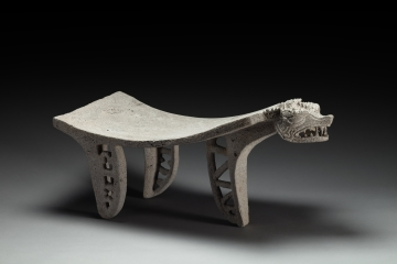 Metate with Serpent Head