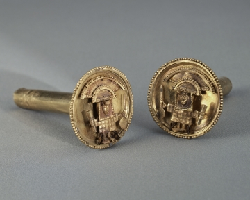 Ear Ornament with Masked Figures