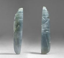 Two Figural Celt Pendants (not a pair)