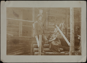 Untitled (Charlie and Nancy Russell on the porch of their Lake McDonald, MT cabin)